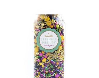 Sweetapolita Twinkle Sprinkles- Fancy Fete 8oz. (Net wt. 7oz)  yellow, purple, green, gold