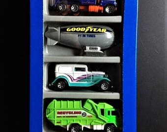 Hot Wheels 5 Vehicle City Action Giftpack 1996 New In Box #17458 Good Humor Truck, Recycling Truck, 32 Delivery, Goodyear Blimp, Towing Rig