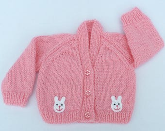 Baby sweater. Premature baby cardigan hand knitted in sugar pink