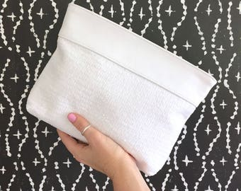 Essie Sequinned Clutch:  White mini-round sequins with White Bovine Leather top trim