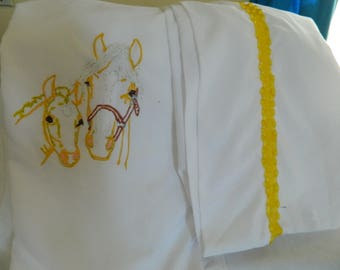queen size pillowcases with horseheads painted on with gold boarder