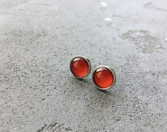 Red stud earrings by CuteBirdie
