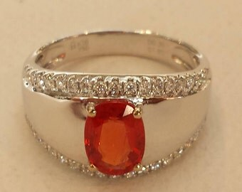 18 K white gold diamond and orange sapphire ring