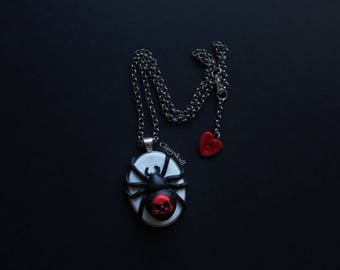Cameo spider skull necklace.