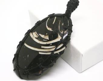 Shell fossil 30X54X6mm macrame pendant
