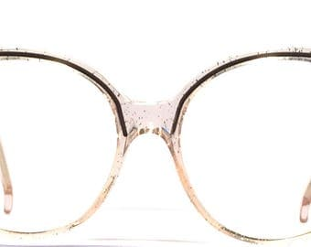 Vintage eyewear. Made in France 1980's. Fun gold and silver sparkles throughout the frame! Excellent quality and condition. Cool Urban Diva
