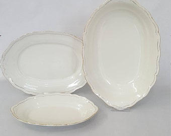 4 piece set porcelain serving bowls with gilded edges marked hare and Czjzek Czechoslovakia