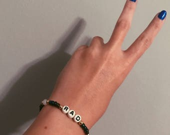 RAD Customizable Black, gold and off-white Beaded Bracelet with block letters
