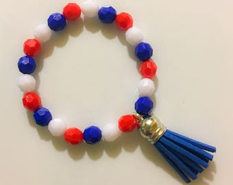 Red, white and blue bracelet with blue tassel