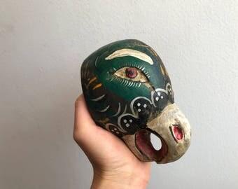 Green little parrot, decorative mask.