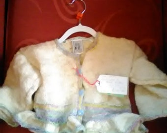 Hand knitted cardigan,  knitted with home spun wool to fit a little girl aged 3-4 years old