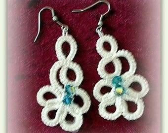 Ivory color earring, made of tatting needle. Swarovski Crystal beads.