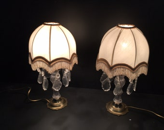 2 table chandeliers or girandoles, French antique, brass and glass base, 1950s. Glass drops, lamp shades. Chateau Chic.