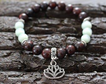 Gemstone bracelet, strength bracelet, poppy jasper, cat eye bead, lotus charm,