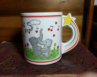 Vintage 1980's Rainbow Handle Dancing Musical Elephants in Love Mug