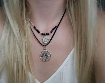 Black cord 'Find your way' compass necklace handmade by Charmed Ivy