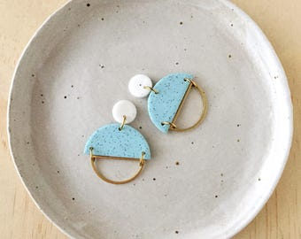 Silhouette Earrings - White Granite & Mint with a Brass Semi Circle Silhouette.