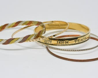 Set five gold and silver tone bangle bracelets