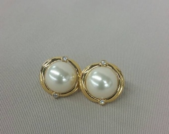 Faux pearl round clip on earrings with rhinestone accents