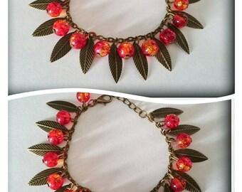Bracelet leaves and red/orange cracked beads