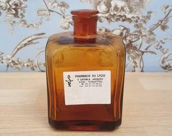 Bottle of pharmacy in orange glass, amber, old pharmacy bottle , medicine