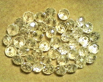 Faceted crystal rondelles;  crystal clear, faceted glass rondelles, slight ab effect, 8x6mm, 14pcs/1.80.