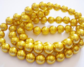 25 glass pearl beads 12 mm gold