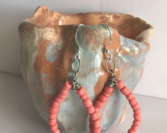 Wire and bead earrings, teal and coral