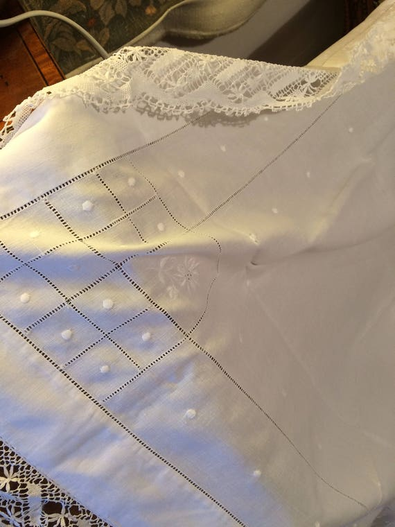 Pretty embroidered lace tablecloth. 37 ins square. Good and strong. Pretty