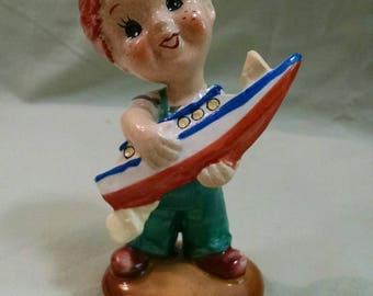 Vintage Japan Boy with Boat Figure