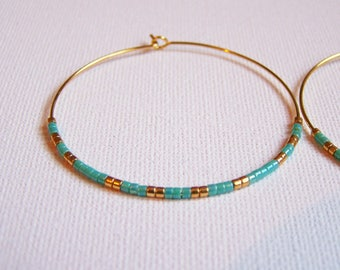 Creole earrings gold and miyuki beads turquoise blue and gold