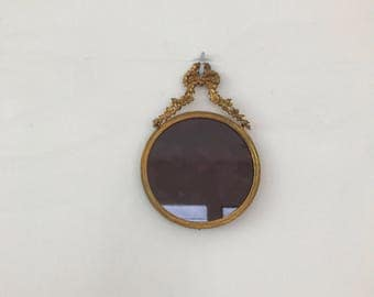 Vintage French gilted round frame with glass