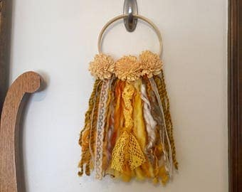 Marigold - Art yarn wall hanging, wall hanging, with hand dyed, hand spun art yarn, lace, and sola flowers, on a wooden hoop