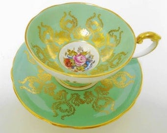 Aynsley artist signed JA Bailey tea cup and saucer, rose & poppy bouquet gold tea cup and saucer, Athens green tea cup, pedestal tea cup