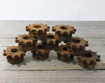 Rusty old sprockets, iron gears, 2 inches in diameter. Priced individually