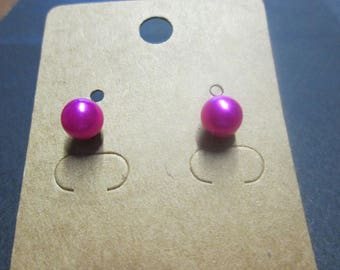 Nice pair of earring studs with a Fuchsia ball