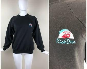Vintage 1980s  Black Rick Dees Weekly Top 40 Pullover Raglan Crew Neck Unisex Sweatshirt | Size: Mens S / Womens M