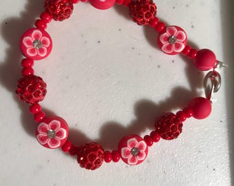 Beaded bracelet with real germs and Flowers