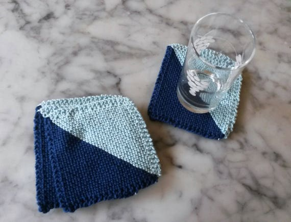 Knit Coasters: navy blue & pale blue knitted coasters. Set of 4 available. Handmade in machine-washable cotton. Made in Ireland. Home gift.