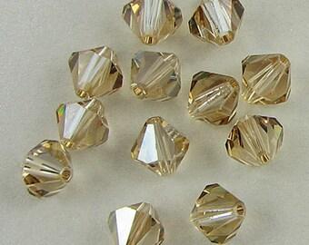 12 8mm Swarovski crystal bicone 5301 Golden Shadow 625