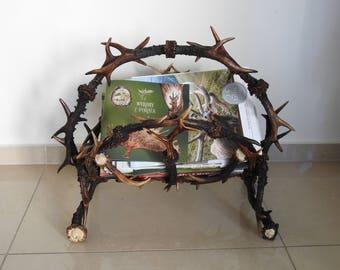 Handmade magazine rack with antlers