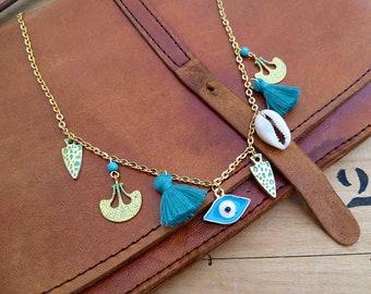 Collier court boho ethnique pompon, or et turquoise, nomade, médaillons antiques patine turquoise, cauris, oeil protecteur, festival boheme