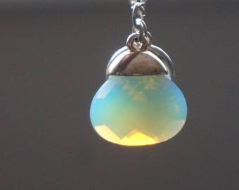 Glowing blue-flash Moonstones Pendant and Avon chain as a present