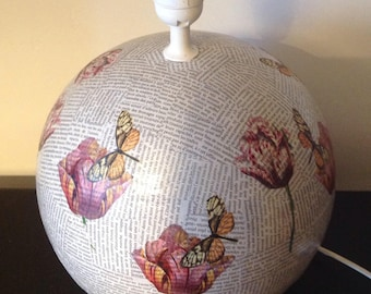 Lamp base decorated with paper collage.