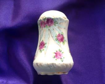 Vintage  hand painted porcelain sugar shaker.