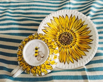 Cup and saucer with a sunflower pattern