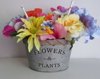 "Garden Themed Silk Flower Arrangement in a Galvanized Pail Featuring ""Flowers & Plants"" and Polka Dot Picks"