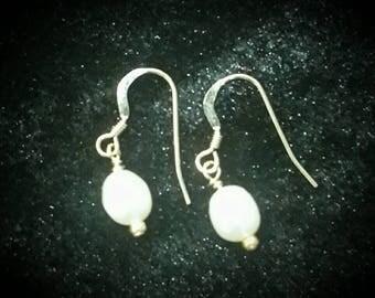 Fresh water pearl earrings.