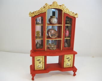 Dolls House One Twelfth Scale Reconditioned Curio Cabinet In Red And Gold  With Contents