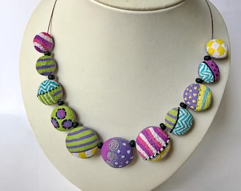 Summer jewelry trend, summer jewelry ideas, summer jewelry, abstract necklace and earrings.